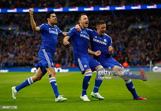 John Terry of Chelsea celebrates scoring the opening goal with Diego Costa and Gary Cahill of Chelsea during the Capital One Cup Final match between...