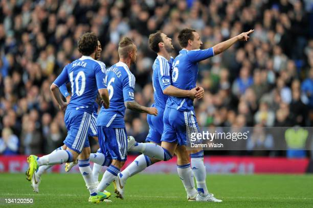 John Terry of Chelsea celebrates scoring the opening goal with teammates during the Barclays Premier League match between Chelsea and Wolverhampton...