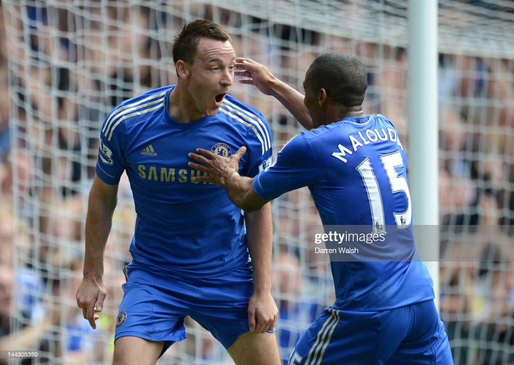 John Terry of Chelsea celebrates scoring their first goal with Florent Malouda during the Barclays Premier League match between Chelsea and Blackburn Rovers at Stamford Bridge on May 13, 2012 in London, England.