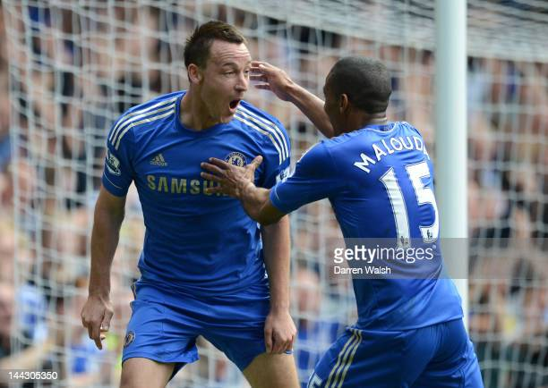 John Terry of Chelsea celebrates scoring their first goal with Florent Malouda during the Barclays Premier League match between Chelsea and Blackburn...