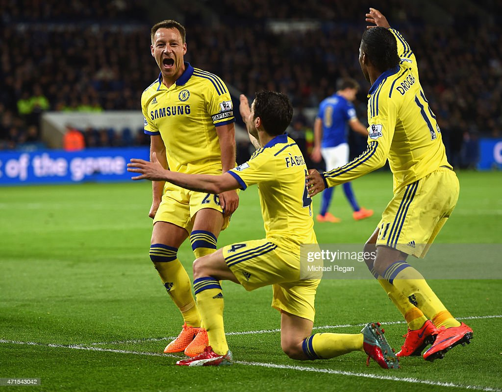 John Terry of Chelsea (L) celebrates scoring their second goal with Cesc Fabregas and Didier Drogba of Chelsea during the Barclays Premier League match between Leicester City and Chelsea at The King Power Stadium on April 29, 2015 in Leicester, England.