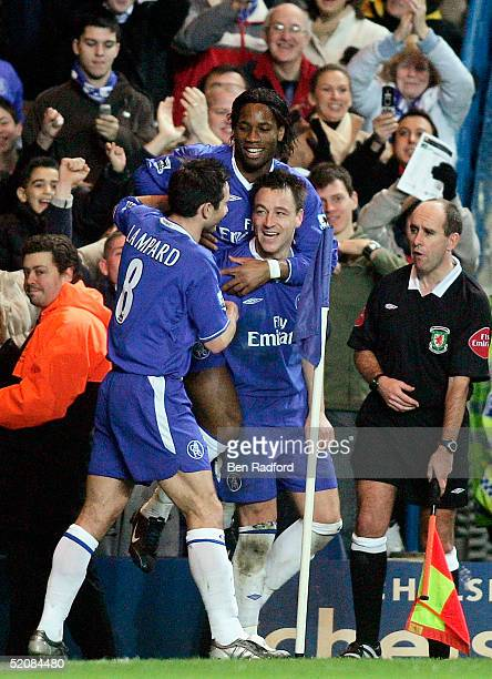 John Terry of Chelsea celebrates scoring their second goal with Frank Lampard and Didier Drogba during the FA Cup Fourth Round match between Chelsea...