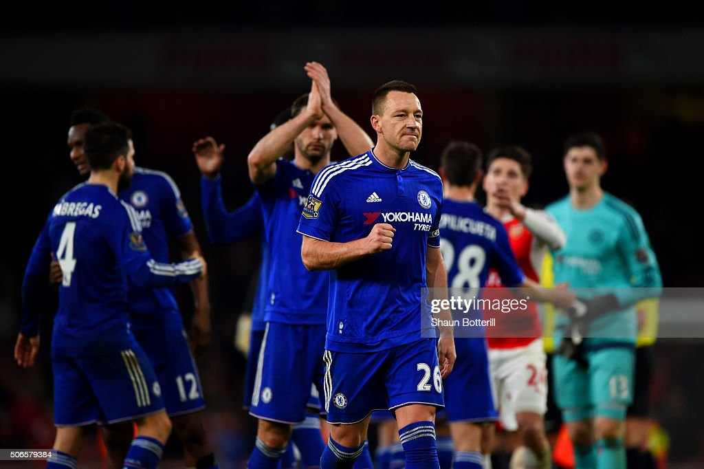 John Terry of Chelsea celebrates with his team-mates after the Barclays Premier League match between Arsenal and Chelsea at Emirates Stadium on January 24, 2016 in London, England.