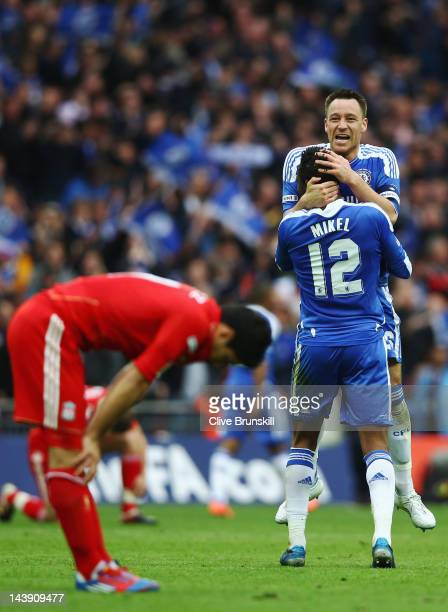 John Terry of Chelsea celebrates with Obi Mikel of Chelsea after victory in the FA Cup with Budweiser Final match between Liverpool and Chelsea at...