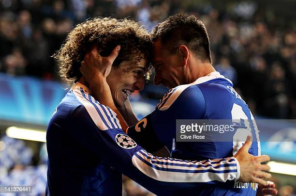John Terry of Chelsea celebrates with teammate David Luiz after scoring his team's second goal during the UEFA Champions League round of 16 second...