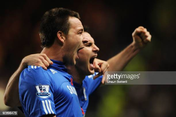 John Terry of Chelsea celebrates with teammate Frank Lampard after scoring the opening goal during the Barclays Premier League match between Chelsea...