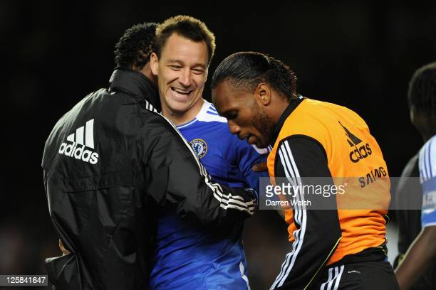 John Terry of Chelsea celebrates with teammates Jon Obi Mikel and Didier Drogba after a penalty shootout victory during the Carling Cup Third Round...