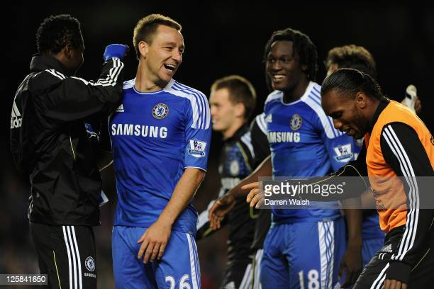 John Terry of Chelsea celebrates with teammates Jon Obi Mikel Romelu Lukaku and Didier Drogba after a penalty shootout victory during the Carling Cup...
