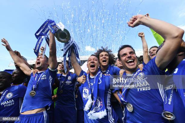 John Terry of Chelsea celebrates with the Premier League Trophy after the Premier League match between Chelsea and Sunderland at Stamford Bridge on...