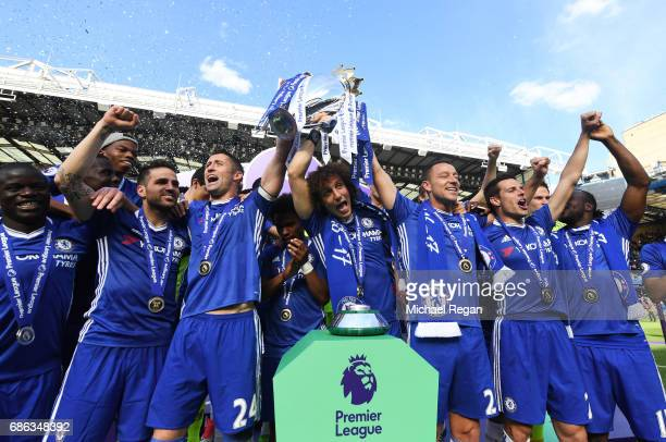 John Terry of Chelsea celebrates with the Premier League Trophy and his Chelsea team mates after the Premier League match between Chelsea and...