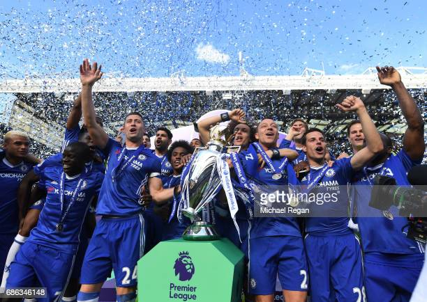 John Terry of Chelsea celebrates with the Premier League Trophy with his Chelsea team mates after the Premier League match between Chelsea and...