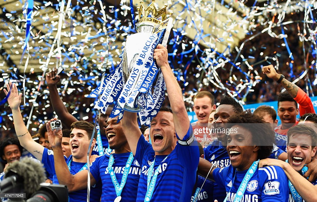 John Terry of Chelsea celebrates with the trophy after the Barclays Premier League match between Chelsea and Sunderland at Stamford Bridge on May 24, 2015 in London, England. Chelsea were crowned Premier League champions.