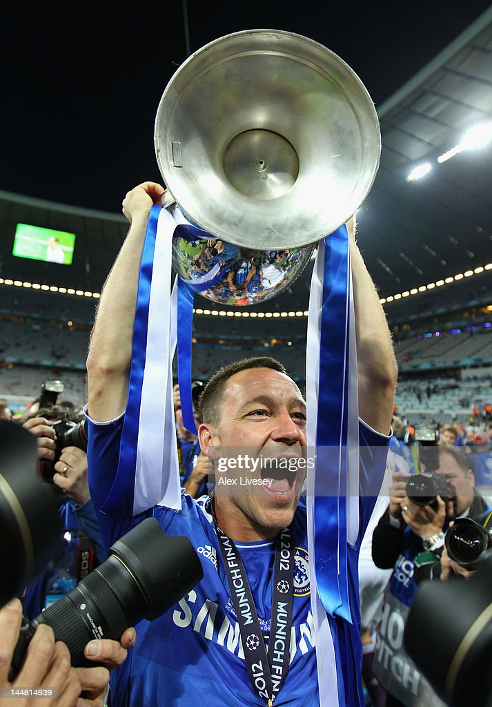John Terry of Chelsea celebrates with the trophy after their victory in the UEFA Champions League Final between FC Bayern Muenchen and Chelsea at the Fussball Arena M?nchen on May 19, 2012 in Munich, Germany.