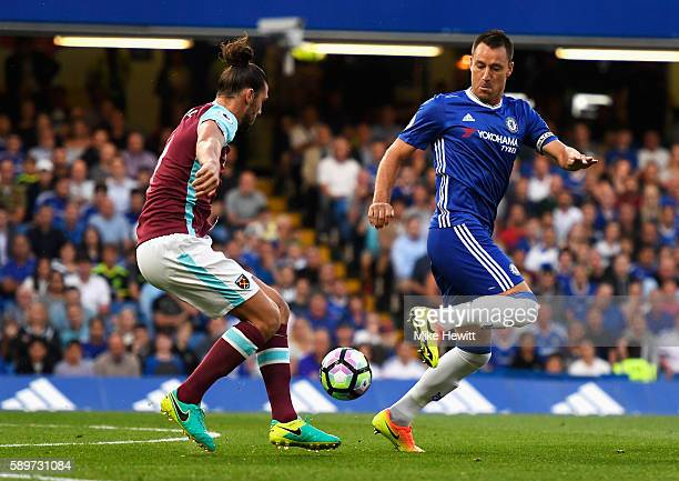 John Terry of Chelsea challenges Andy Carroll of West Ham United during the Premier League match between Chelsea and West Ham United at Stamford...