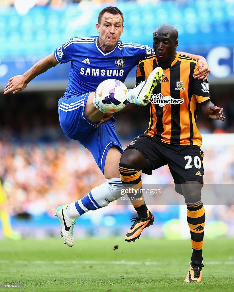 John Terry of Chelsea challenges Yannick Sagbo of Hull City during the Barclays Premier League match between Chelsea and Hull City at Stamford Bridge on August 18, 2013 in London, England.