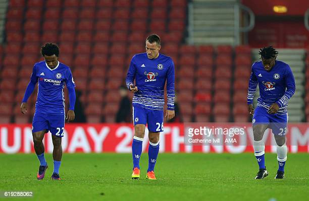 John Terry of Chelsea checks a stopwatch as he appears to take charge of a training session after the Premier League match between Southampton and...