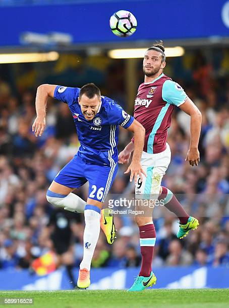 John Terry of Chelsea clashes with Andy Carroll of West Ham United during the Premier League match between Chelsea and West Ham United at Stamford...