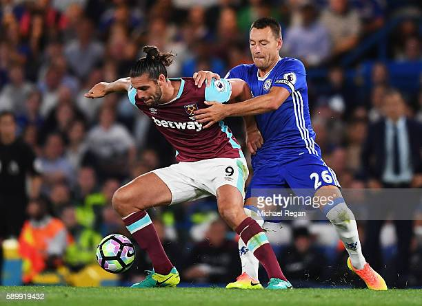 John Terry of Chelsea closes down Andy Carroll of West Ham United during the Premier League match between Chelsea and West Ham United at Stamford...