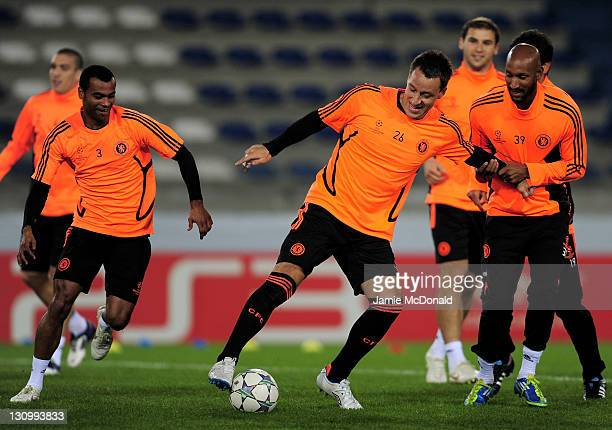 John Terry of Chelsea competes with team mates Ashley Cole and Nicolas Anelka during a training session prior to the Champions League Group E match...