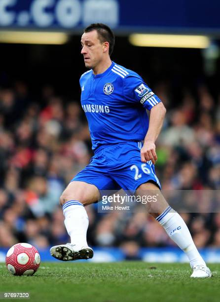 John Terry of Chelsea controls the ball during the Barclays Premier League match between Chelsea and West Ham United at Stamford Bridge on March 13...