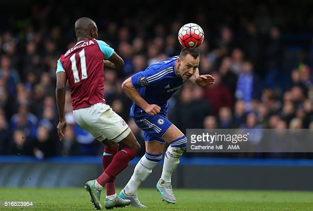 John Terry of Chelsea defends from Enner Valencia of West Ham United during the Barclays Premier League match between Chelsea and West Ham United at...