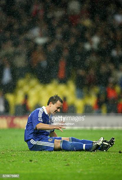 John Terry of Chelsea falls over whilst taking a penalty during the shoot out which lead to Manchester United winning the UEFA Champions League 2008...
