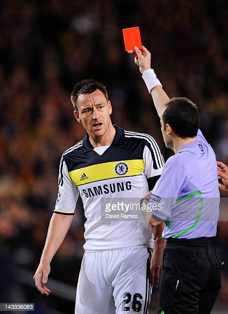 John Terry of Chelsea FC reacts as he is shown a red card by referee Cuneyt Cakir during the UEFA Champions League Semi Final second leg match...