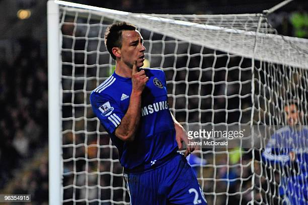 John Terry of Chelsea gestures following his team's first goal during the Barclays Premier League match between Hull City and Chelsea at the KC...