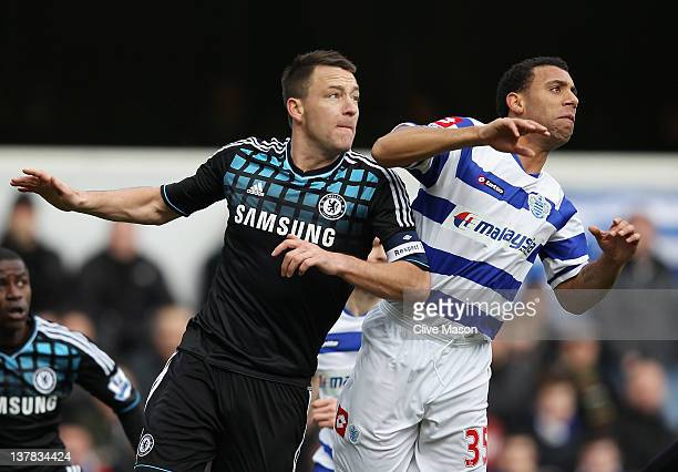 John Terry of Chelsea goes up for a header with Anton Ferdinand of Queens Park Rangers during the FA Cup with Budweiser Fourth Round match between...