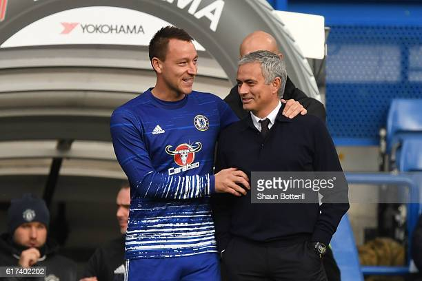 John Terry of Chelsea greets Jose Mourinho, Manager of Manchester United prior to the Premier League match between Chelsea and Manchester United at...