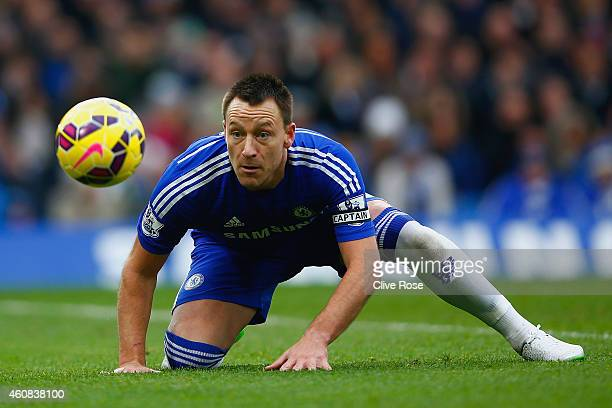 John Terry of Chelsea heads the ball during the Barclays Premier League match between Chelsea and West Ham United at Stamford Bridge on December 26...