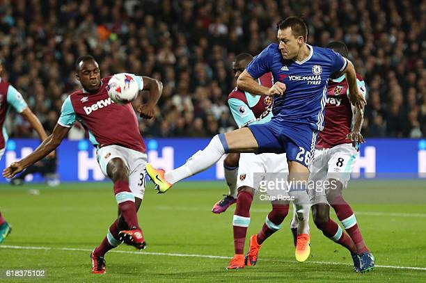 John Terry of Chelsea heads the ball towards goal during the EFL Cup fourth round match between West Ham United and Chelsea at The London Stadium on...