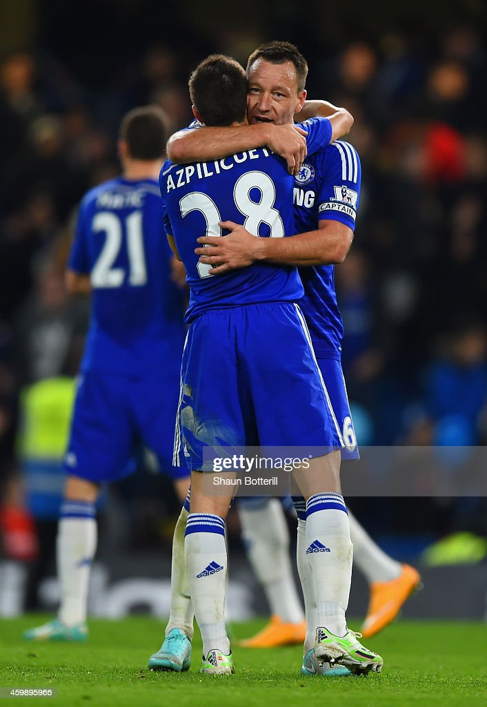 John Terry of Chelsea hugs Cesar Azpilicueta of Chelsea after victory in the Barclays Premier League match between Chelsea and Tottenham Hotspur at Stamford Bridge on December 3, 2014 in London, England.