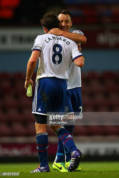 John Terry of Chelsea hugs Frank Lampard of Chelsea at the final whistle during the Barclays Premier League match between West Ham United and Chelsea...