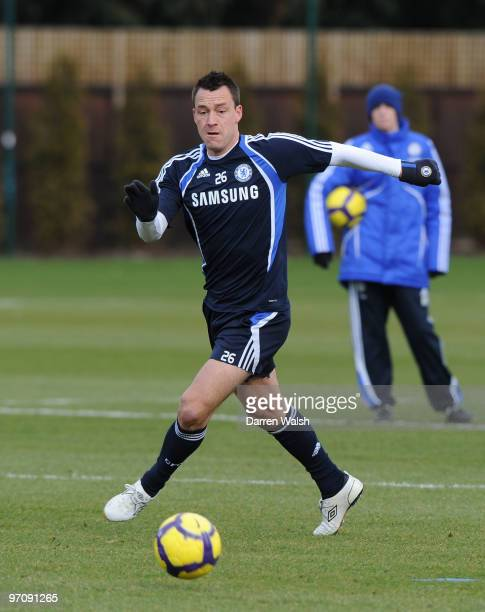 John Terry of Chelsea in action during a training session at the Cobham training ground on February 26, 2010 in Cobham, England.