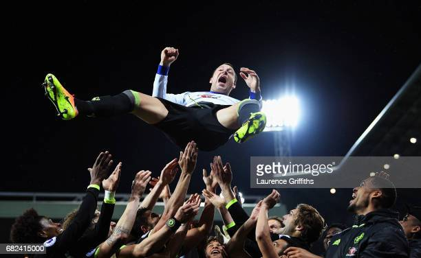 John Terry of Chelsea is chucked in the air by team mates while celebrating winning the leauge title after the Premier League match between West...