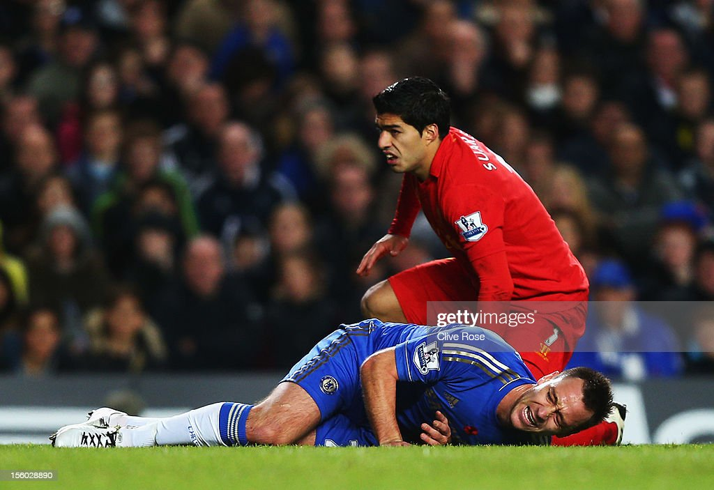 John Terry of Chelsea is injured in a collision with Luis Suarez of Liverpool during the Barclays Premier League match between Chelsea and Liverpool at Stamford Bridge on November 11, 2012 in London, England.