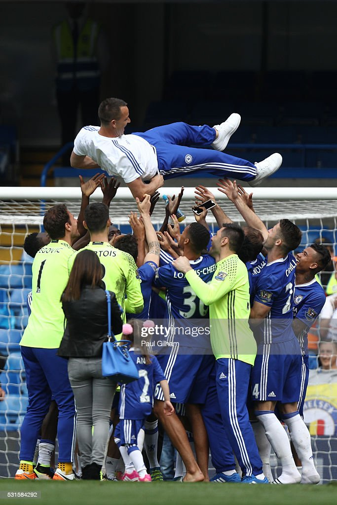 John Terry of Chelsea is thrown into the air after the Barclays Premier League match between Chelsea and Leicester City at Stamford Bridge on May 15, 2016 in London, England.