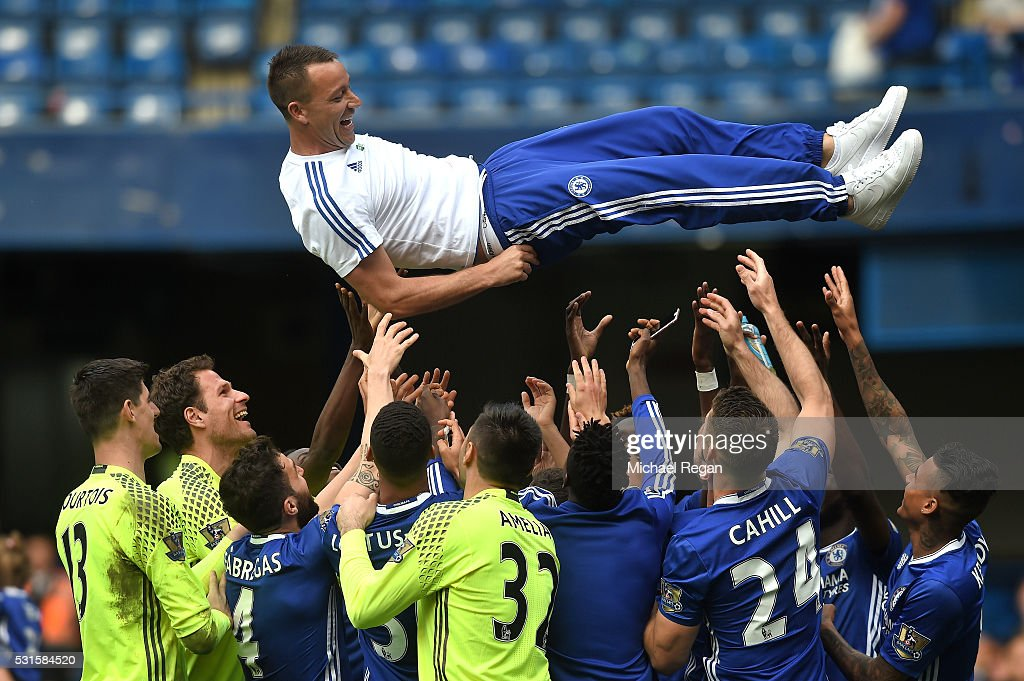 John Terry of Chelsea is thrown into the air by team mates after the Barclays Premier League match between Chelsea and Leicester City at Stamford Bridge on May 15, 2016 in London, England.