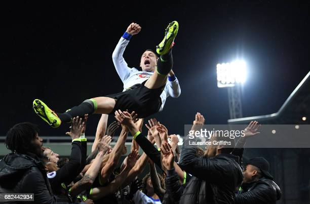 John Terry of Chelsea is thrown into the air in celebration after winning the title after the Premier League match between West Bromwich Albion and...