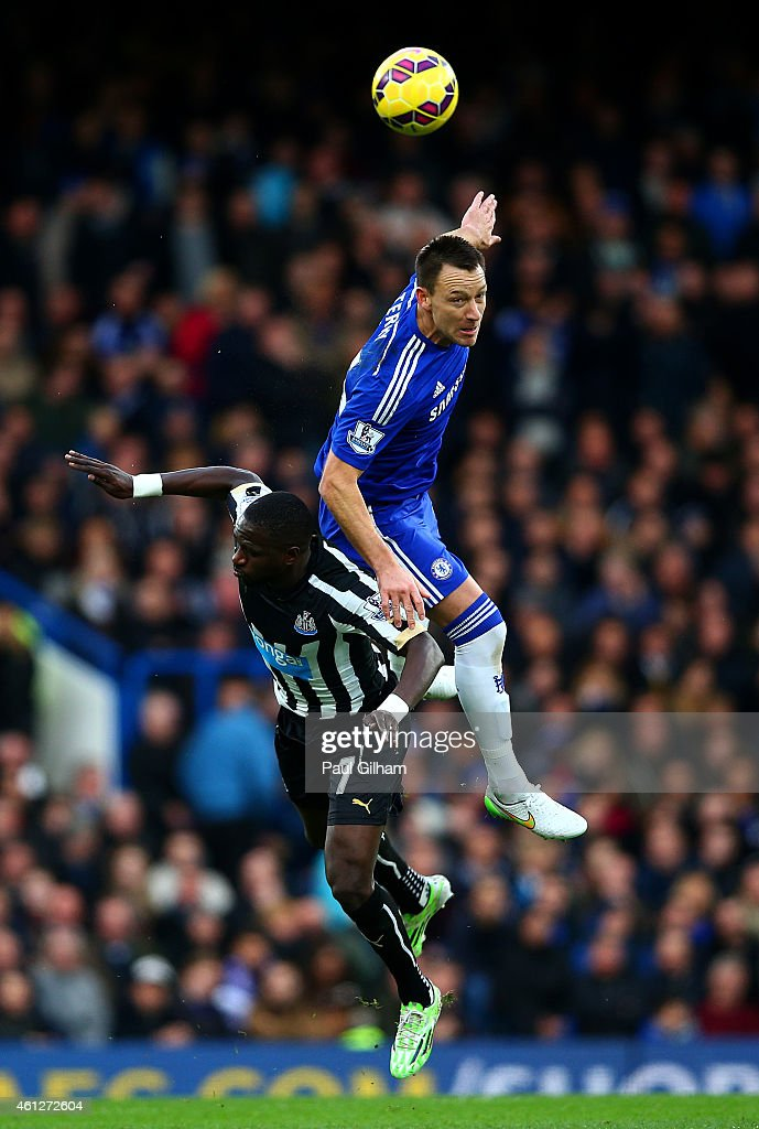 John Terry of Chelsea jumps for the ball with Moussa Sissoko of Newcastle United during the Barclays Premier League match between Chelsea and Newcastle United at Stamford Bridge on January 10, 2015 in London, England.