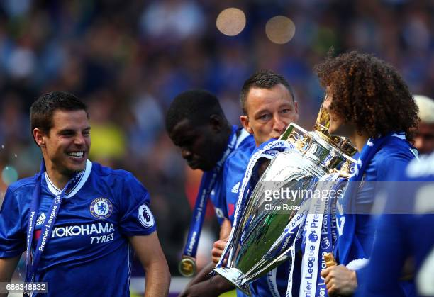John Terry of Chelsea kisses the Premier League Trophy after the Premier League match between Chelsea and Sunderland at Stamford Bridge on May 21...
