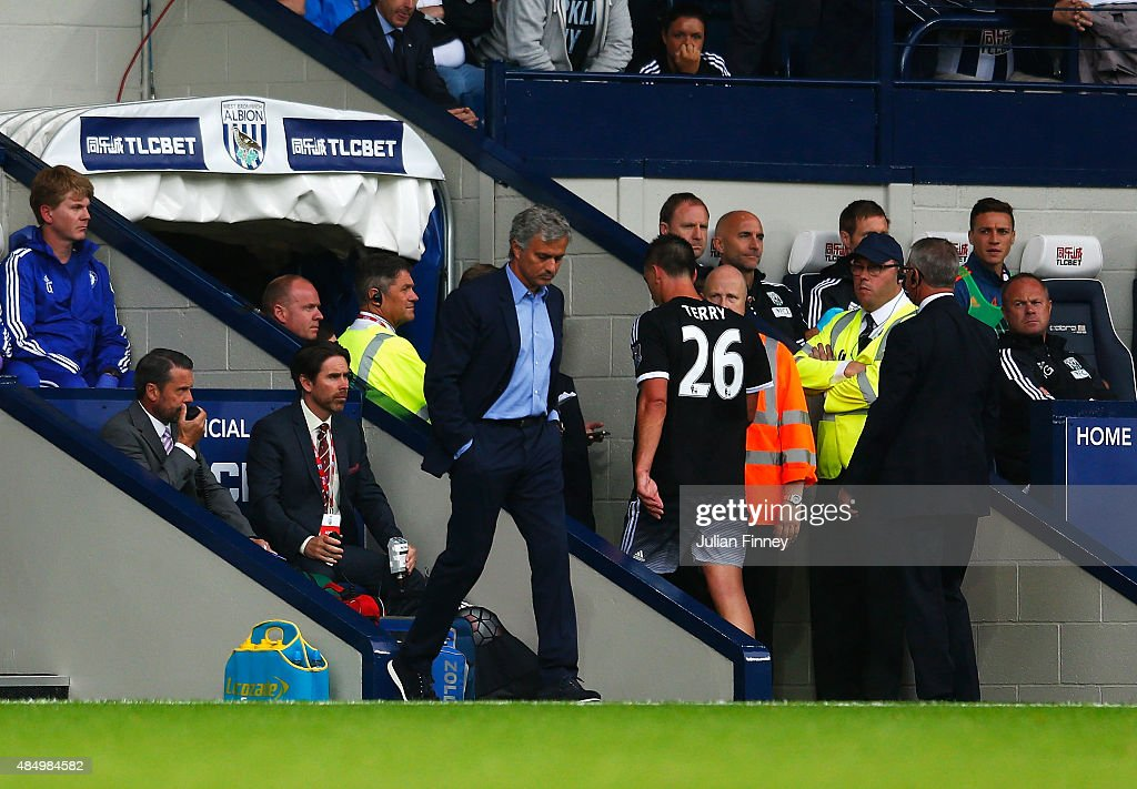 John Terry of Chelsea leaves the pitch after being sent off as Jose Mourinho, manager of Chelsea looks on during the Barclays Premier League match between West Bromwich Albion and Chelsea at The Hawthorns on August 23, 2015 in West Bromwich, England.