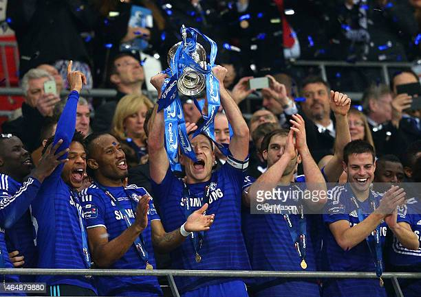 John Terry of Chelsea lifts the Capital One Cup trophy during the Capital One Cup Final match between Chelsea and Tottenham Hotspur at Wembley...