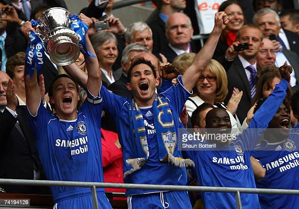 John Terry of Chelsea lifts the FA Cup trophy following the FA Cup Final match sponsored by E.ON between Manchester United and Chelsea at Wembley...