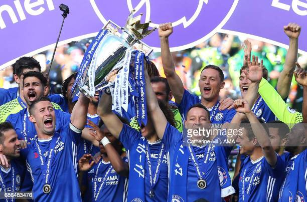 John Terry of Chelsea lifts the Premier League trophy after the Premier League match between Chelsea and Sunderland at Stamford Bridge on May 21 2017...