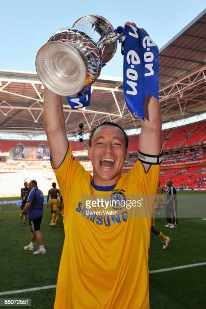 John Terry of Chelsea lifts the trophy after the FA Cup sponsored by EON Final match between Chelsea and Everton at Wembley Stadium on May 30 2009 in...