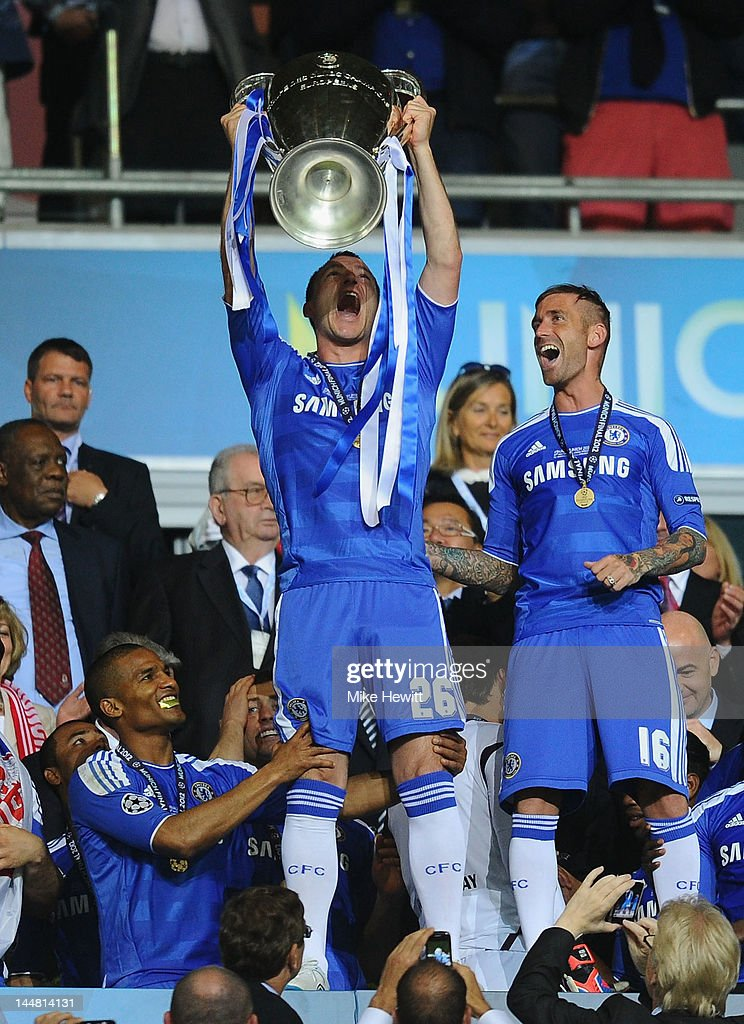 John Terry of Chelsea lifts the trophy in celebration after their victory in the UEFA Champions League Final between FC Bayern Muenchen and Chelsea at the Fussball Arena M?nchen on May 19, 2012 in Munich, Germany.