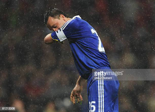 John Terry of Chelsea looks dejected as he misses a penalty kick in the shootout during the UEFA Champions League Final match between Manchester...