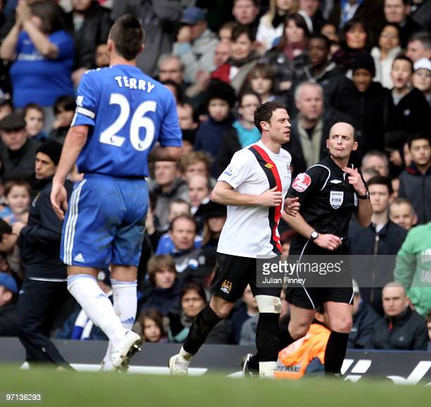 John Terry of Chelsea looks on as Wayne Bridge of Manchester City is substituted off during the Barclays Premier League match between Chelsea and...